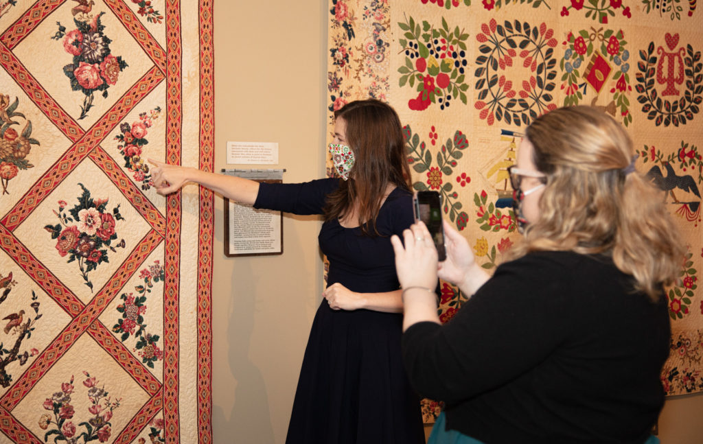 A curator gives a tour of the Wild and Untamed exhibition.